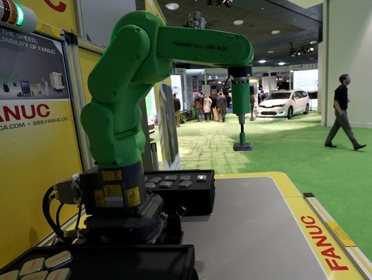 At the entrance to AutoMobili-D, a robot by Fanuc is