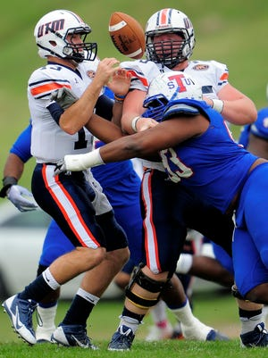Tennessee State defensive lineman Samquan Evans (93) forces UT Martin quarterback Jarod Neal (13) to fumble during the first quarter Saturday.