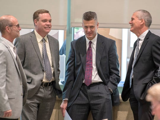Braidy Industries aluminum mill senior managers  Dave Durci, left, Gregg Whigham, Curtis Carson, and Shane Schuler, gather before an informational meeting at Ashland Community and Technical College Thursday, March 8, 2018, near Ashland, Ky. Braidy Industries plans to build a 2.5 million square-foot aluminum mill on a 204-acre lot near the college.