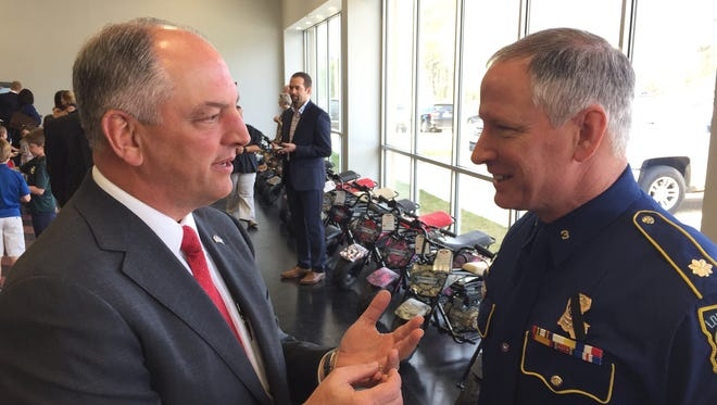 In this 2017 file photo, Louisiana Gov. John Bel Edwards speaks to State Police Col. Kevin Reeves.