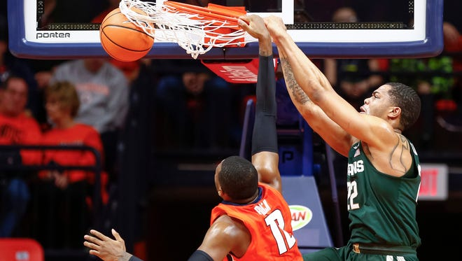 Miles Bridges #22 of the Michigan State Spartans dunks the ball against Leron Black #12 of the Illinois Fighting Illini at State Farm Center on January 22, 2018 in Champaign, Illinois.