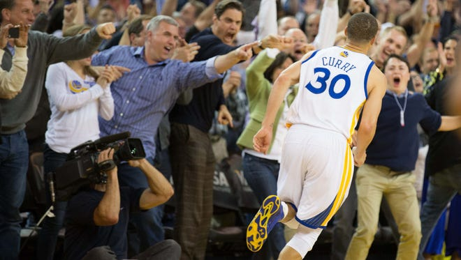 Fans celebrate after a basket by Golden State Warriors guard Stephen Curry (30) during the fourth quarter against the Memphis Grizzlies.
