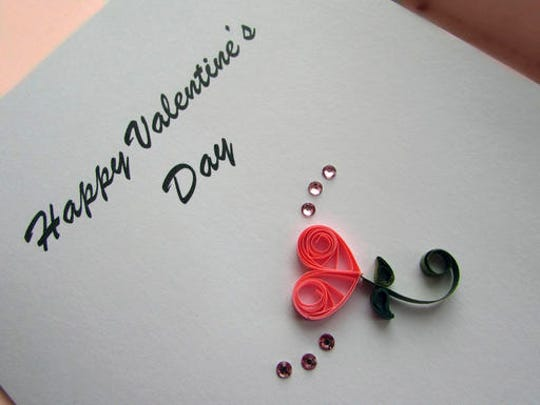 In this image provided by Kari Cronbaugh-Auld of Olathe, Kan., two teardrop coils and two smaller bent teardrop coils combine with an open coil scroll to create a heartfelt message. Quilling, which involves rolling thin strips of paper into various coil shapes and many other techniques, adds extra elegance to a Valentine's Day greeting.