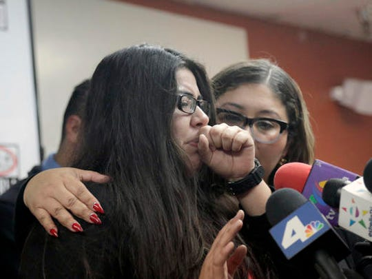 Marlene Mosqueda, left, who's father was deported early Friday, Feb. 10, 2017, is comforted at a news conference by her attorney Karla Navarrette at The Coalition for Humane Immigrant Rights of Los Angeles (CHIRLA). Navarrete, said she sought to stop Mosqueda from being placed on a bus to Mexico and was told by ICE that things had changed. She said another lawyer filed federal court papers to halt his removal.