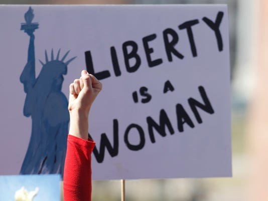 Liberty in a woman sign