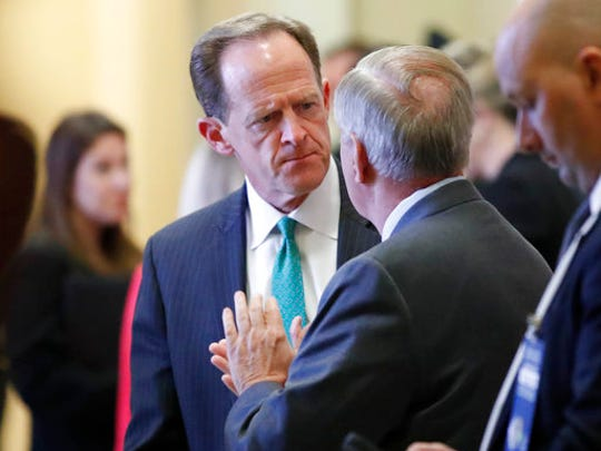 Sen. Pat Toomey, R-Pa., left, and Sen. Lindsey Graham, R-S.C. talk on Capitol Hill in Washington, Tuesday, April 25, 2017. Graham says he emerged from a dinner meeting with Donald Trump confident the president will not allow North Korea to build a nuclear-tipped missile capable of striking the United States.
