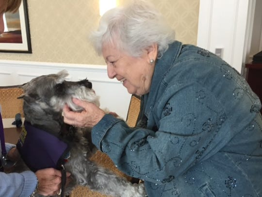 Smokey looks into the eyes of a senior, and his eyes