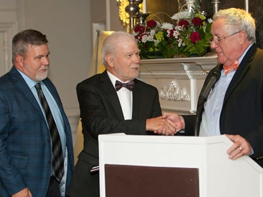 Bill and Bob Auld accept Raritan Valley Habitat for