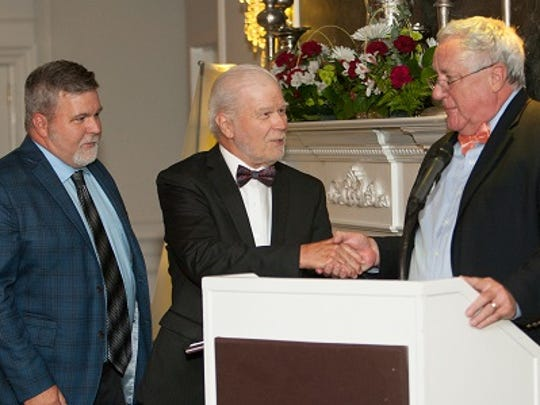 Bill and Bob Auld accept Raritan Valley Habitat for Humanity's award from Construction Manager David Polomski.