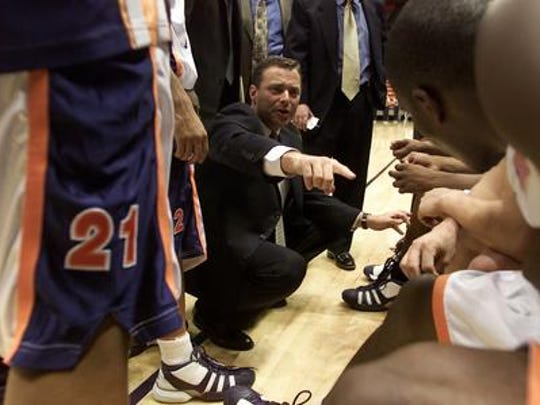Former UTEP men's basketball coach Billy Gillispie talks to players during a team huddle. He is now the head coach at Ranger Junior College.