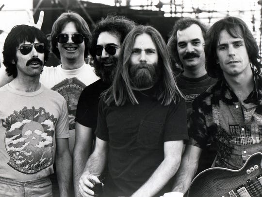 The early 1980s Grateful Dead, from left: Mickey Hart, Phil Lesh, Jerry Garcia, Brent Mydland, Bill Kreutzmann, and Bob Weir. The Grateful Dead used a dancing bear logo in the early 1970s and architecture historian Debra Jane Seltzer says the band's logo may have derived from one used by Bear Manufacturing Co.