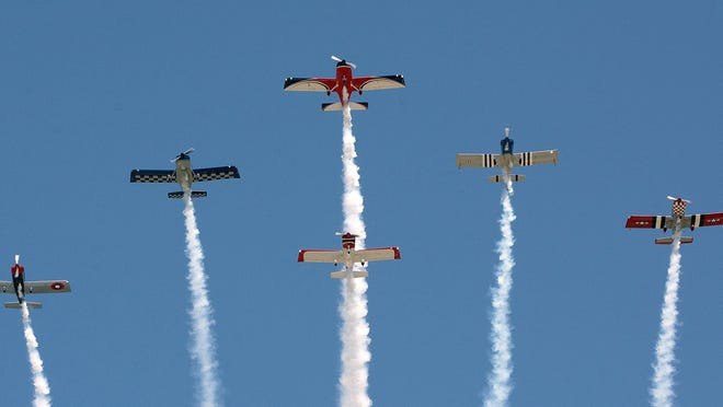 """Six members of the Bandits flyover team make their way south 1,000 feet above Main Street in Hendersonville on Monday, serving as a """"parade in the sky"""" in lieu of the annual King Apple parade that officially closes out the city's annual N.C. Apple Festival. The parade was canceled due to the coronavirus pandemic."""
