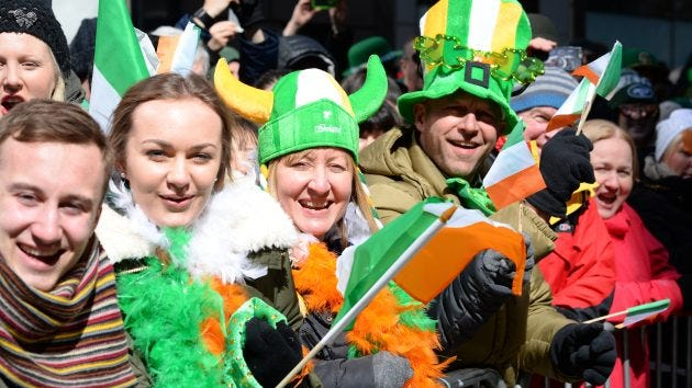 Fans watch the 2017 St. Patrick's Day Parade on NYC's Fifth Avenue.