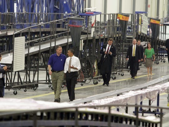 President Barack Obama tours the 350,000-square-foot