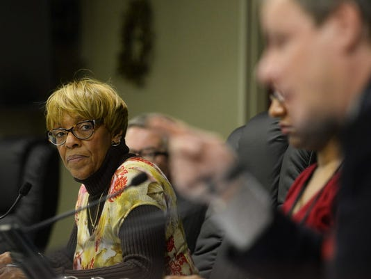 In this file photo from Tuesday, Dec. 16, 2014, York city council president Carol Hill-Evans, left, listens as council member Michael Helfrich speaks on a proposed amendment to the city's proposed 2015 budget during a York city council meeting.