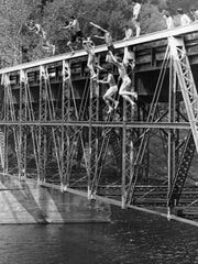 File Photo In this photo from 1973, boys are jumping from the old bridge crossing the Jersey City Reservoir on Parsippany Boulevard at the Boonton border. The jump was a right of passage of sorts in those days for boys in nearby neighborhoods in Parsippany, Boonton and Mountain Lakes. The bridge was preserved as a park after it was replaced by a larger span in 2004. The new bridge has high fencing that prevents this stunt, which was especially dangerous when the reservoir's water line was low.