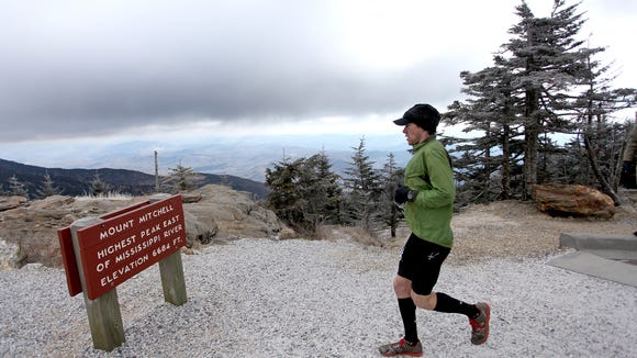 Scott Williams summits Mount Mitchell in a past Mt. Mitchell 40-mile Challenge. The state park in Yancey County is now closed.