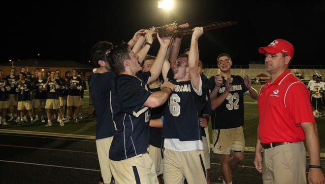 Cathedral lacrosse players celebrate winning the state title  Saturday over Carmel.