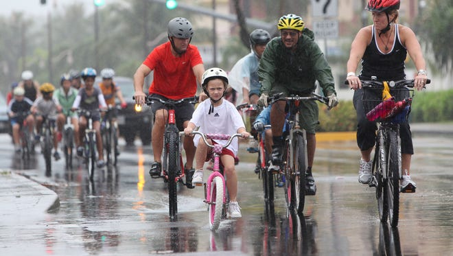 Cyclist ride along the streets of Tumon during a Guam Cycling Federation's iBike village ride. To keep safe on the roads, cyclists should think of their bikes as a car and follow traffic laws. Motorists must pay attention and should give cyclists space to ride.