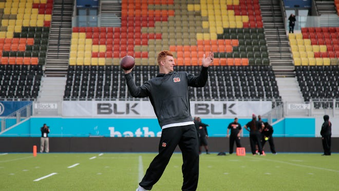 Cincinnati Bengals quarterback Andy Dalton (14) throws a pass during the team's practice at Allianz Park, Friday, Oct. 28, 2016, ahead of their game against the Washington Redskins at Wembley Stadium in London.