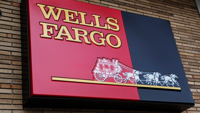 File photo taken in 2010 shows a Wells Fargo sign outside a bank branch in  Palo Alto, Calif.
