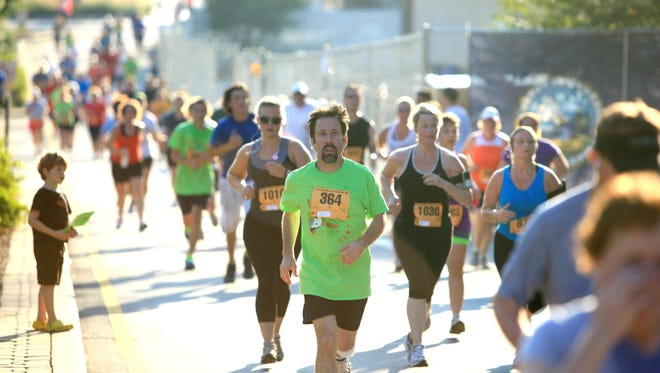 Runners take part in a past Bele Chere 5K through downtown Asheville. June 7 is World Run Day.