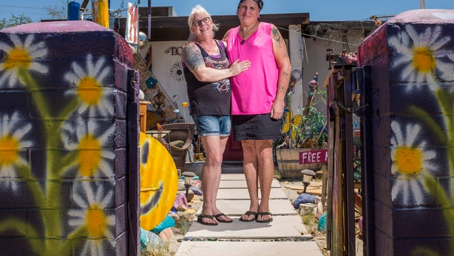 Jennifer Nicole Sweet, left, and her wife Candice Marie Sweet in front of their Palm Springs home on Thursday, June 29, 2017.