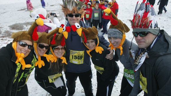 Gathering friends before the start of the Webster Turkey Trot (which would be at Holt Road) at Webster Park in Webster, N.Y. on Thursday, November 28 2013. The course, mainly on the road and with the last 3/4 mile on trail in Webster Park, included distances of 4.4 and 2.5 miles.