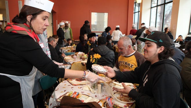 The Sharing Community hosted the 31st annual community Thanksgiving dinner for nearly 250 people, Nov. 27, 2014 in Yonkers.