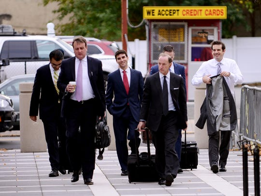 Members of the defense team for U.S. Sen. Bob Menendez arrive at Martin Luther King Jr. Federal Court on Thursday in Newark.