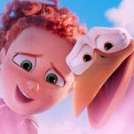 "Tulip, left, voiced by Katie Crown, and Junior, voiced by Andy Samberg, try to deliver an unauthorized baby girl and not get in trouble in ""Storks."""