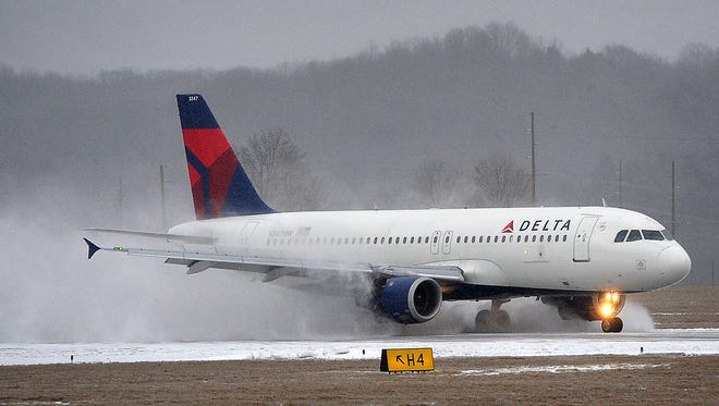 This Delta airliner kicks up snow as it was one of the last to land at the Nashville International Airport ahead of a winter storm promising snow, sleet, ice and finally rain. Friday Feb. 20, 2015, in Nashville, TN