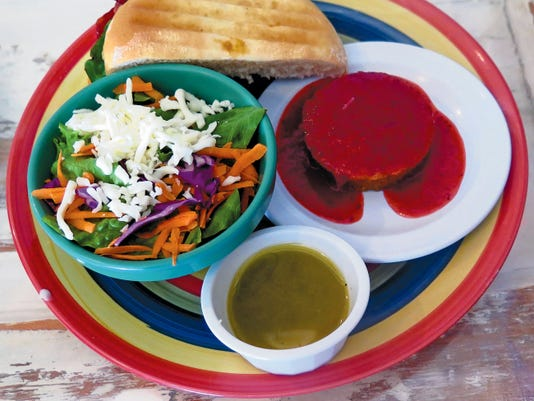 La Tierra's Daily Comida Corrida includes, at left, a side salad with balsamic vinaigrette, half a sandwich and dessert. The special also includes a drink and a cup of soup.