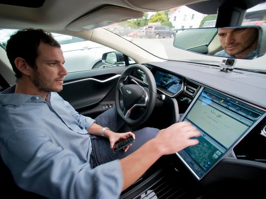 Cleared for takeoff: Will Nicholas, the Tesla Motors regional sales manager for New England, explains features of the control screen on a Model S 85.