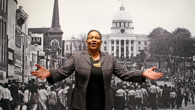 Lynda Blackmon Lowery speaks during a Martin Luther King Jr. Day appearance at the New York Historical Society on Sunday. She told of her experiences as the youngest participant in the 1965 march from Selma to Montgomery, Alabama, demanding voting rights for African-Americans. Lowery stands in front of a Stephen Somerstein photo of the march, on view at the museum.