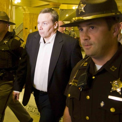 David Camm (center) is shown walking out of the Boone County Courthouse as a free man on Oct. 24, 2013, after being found not guilty of killing his wife Kim Camm and children Jill and Bradley in 2000. This was Camm's third trial in the case; his convictions in the first two trials were overturned on appeal.