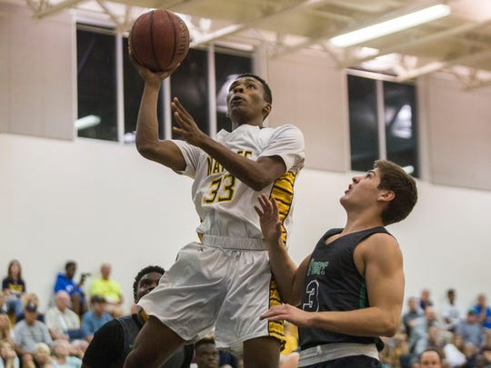 Naples' Sevin Brown attempts a layup during the Class
