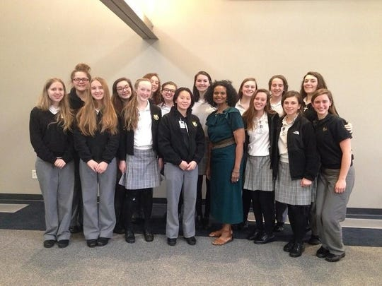 """Students from Padua Academy women's chorus and music theory classes attended """"The Folk Music of African Americans"""" program at the Delaware History Museum presented by Dr. Devonna B. Rowe (center)."""