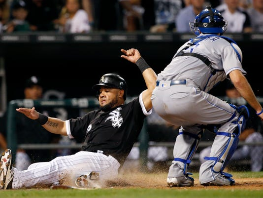 Chicago White Sox's Melky Cabrera, left, scores on a single by Justin Morneau as Kansas City Royals catcher Drew Butera applies a late tag during the fifth inning of a baseball game Friday, Sept. 9, 2016, in Chicago. (AP Photo/Nam Y. Huh)