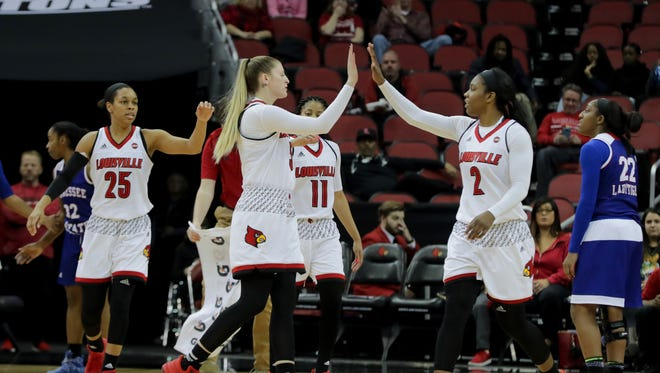 Louisville's Sam Fuehring and Myisha Hines-Allen congratulate each other on a good defensive stand.