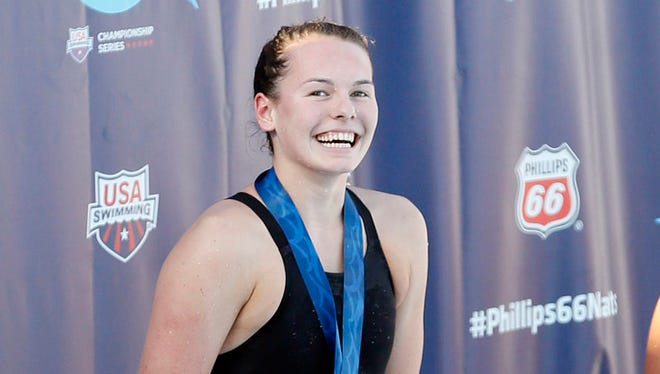 Claire Adams celebrates after winning in the women's 100-meter backstroke final during the Phillips 66 National Championships in August 2015 at Northside Swim Center in San Antonio, Texas.