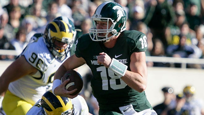 Michigan State quarterback Connor Cook (18) runs on a keeper against Michigan on Saturday, Oct. 25, 2014, in East Lansing.
