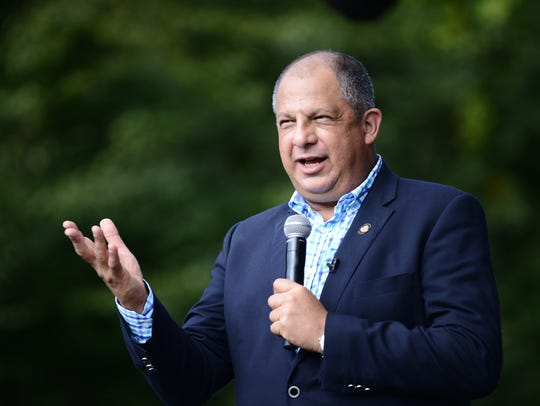 Costa Rican President Luis Guillermo Solís speaks to