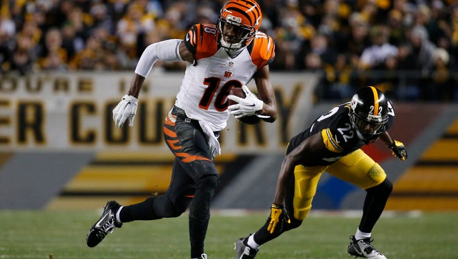 The Cincinnati Bengals wide receiver A.J. Green (18) runs the ball after a reception against the Pittsburgh Steelers at Heinz Field.