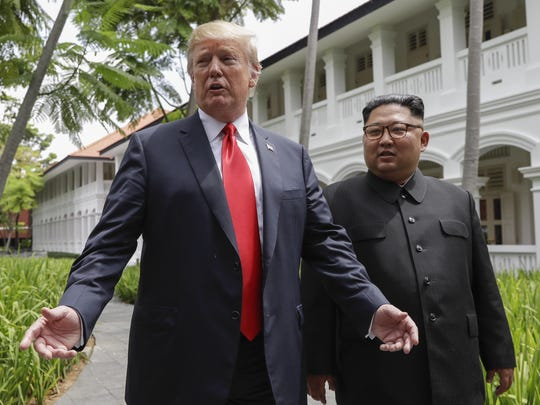 President Donald Trump and North Korea leader Kim Jong Un stop to talk with the media at the Capella resort on Sentosa Island Tuesday in Singapore. Evan Vucci/AP U.S. President Donald Trump and North Korea leader Kim Jong Un stop to talk with the media as they walk from their lunch at the Capella resort on Sentosa Island Tuesday, June 12, 2018 in Singapore. (AP Photo/Evan Vucci)