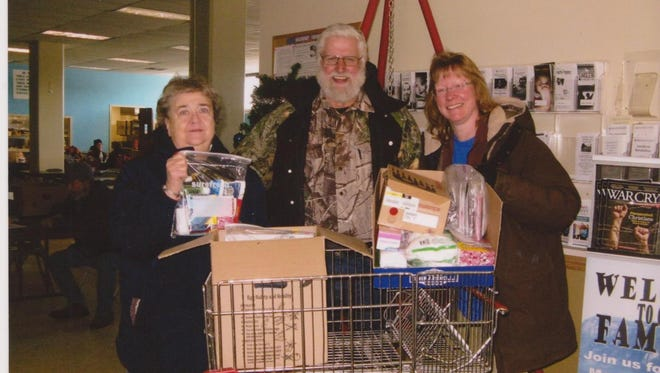 Members Marcell and Janice Wieloch, on behalf of Western Fraternal Life Lodge No. 144, Mosinee, are pictured presenting bags of toiletries, a stocking cap, socks, handwarmers, and more, to the Salvation Army to help those in need.