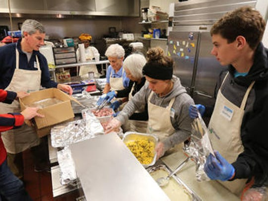 Volunteers prepare Thanksgiving dinner for Lifting