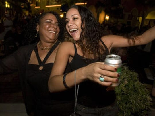Lynette Vesely celebrates with her daughter Nikitia Vesely, 22, at  Cape Harbour New Year's Eve bash in Cape Coral.