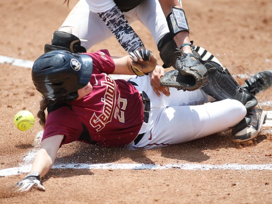 FSU's Macey Cheatham slides home safely against UCF during their NCAA Regional Championship game at Joanne Graf Softball Field on Sunday.