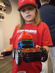 Cassidy Etzel, 9 years old, shows her Magformers creation.